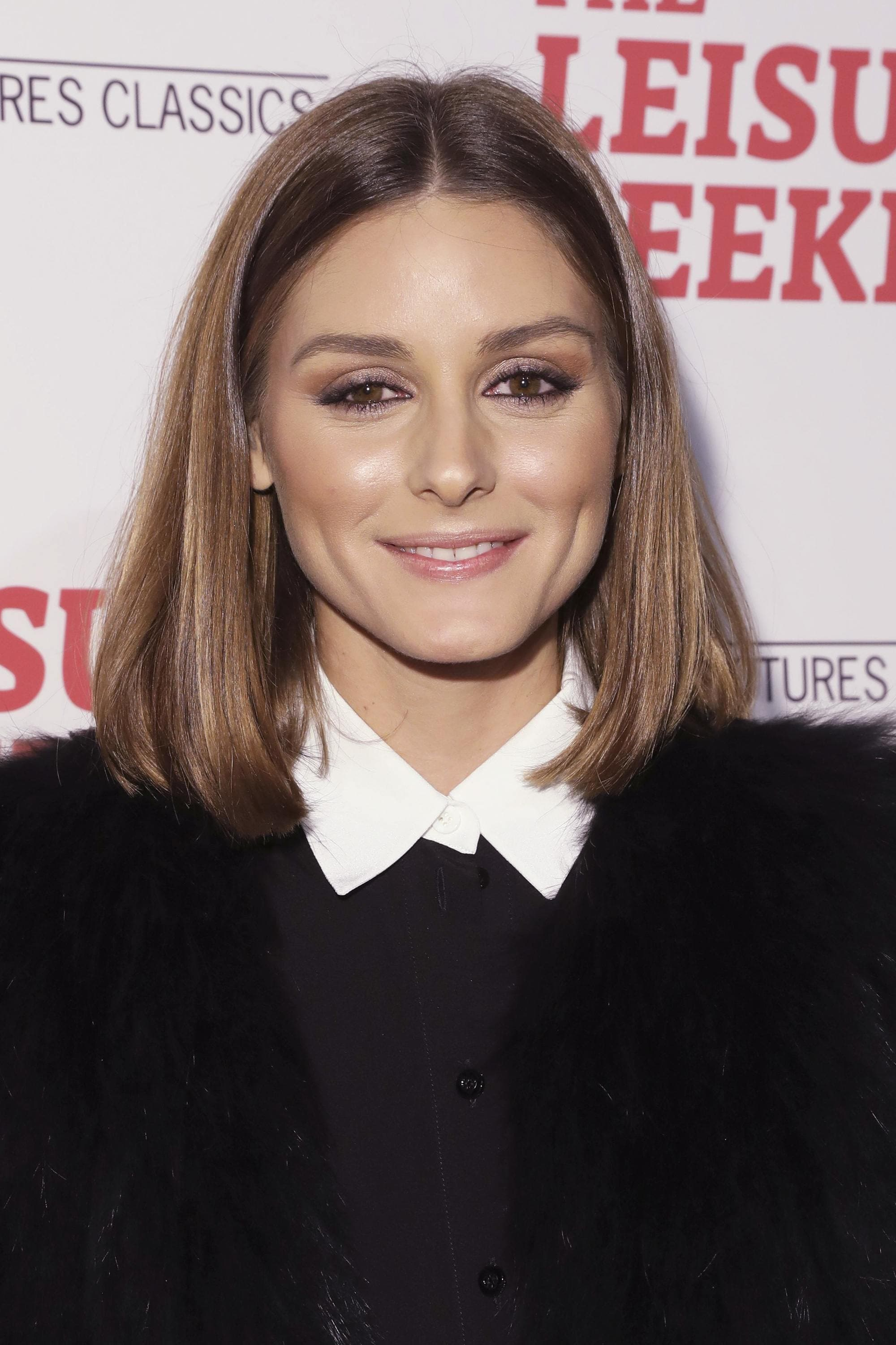 Haircuts for fine straight hair: Olivia Palermo with an ashy brown blunt cut bob, wearing a white collared shirt and blazer