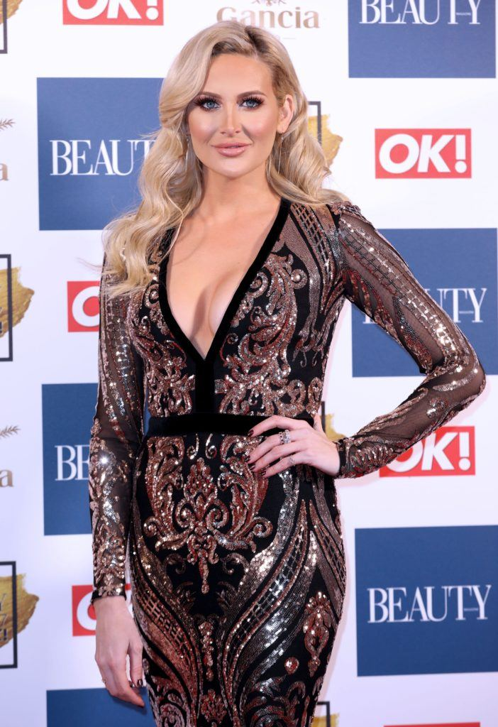 shot of stephanie pratt on the ok beauty awards red carpet with glam waves hairstyle, wearing sequin dress