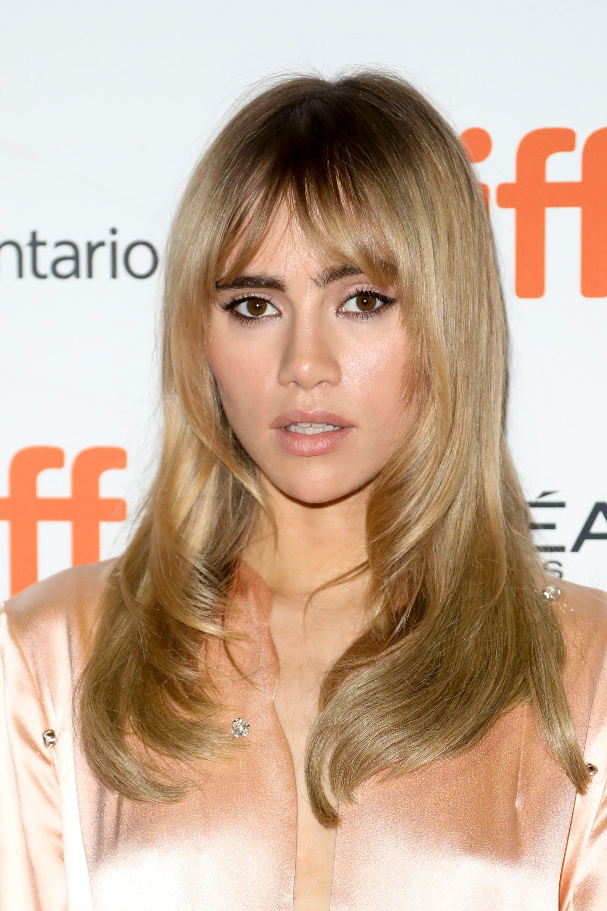 Haircuts for fine straight hair: Suki Waterhouse with '70s inspired long layers and a split fringe