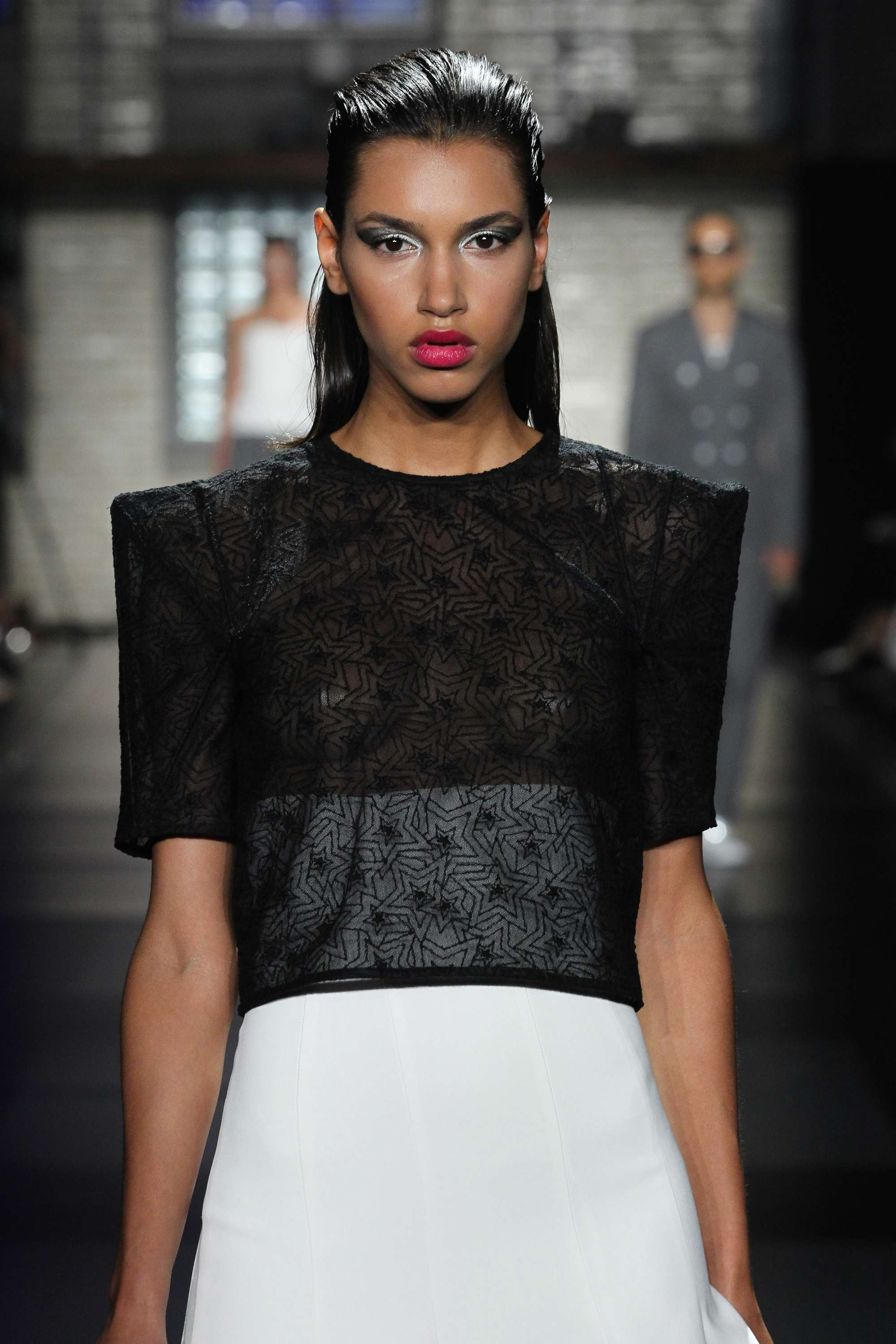 Ideas for crazy hair day: Runway model with dark brunette wet look slicked back hair