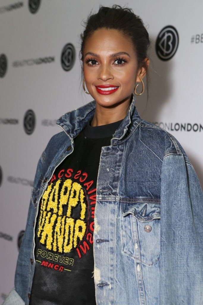 close up shot of alesha dixon with slick back hair, wearing black and denim on the beautycon london festival red carpet