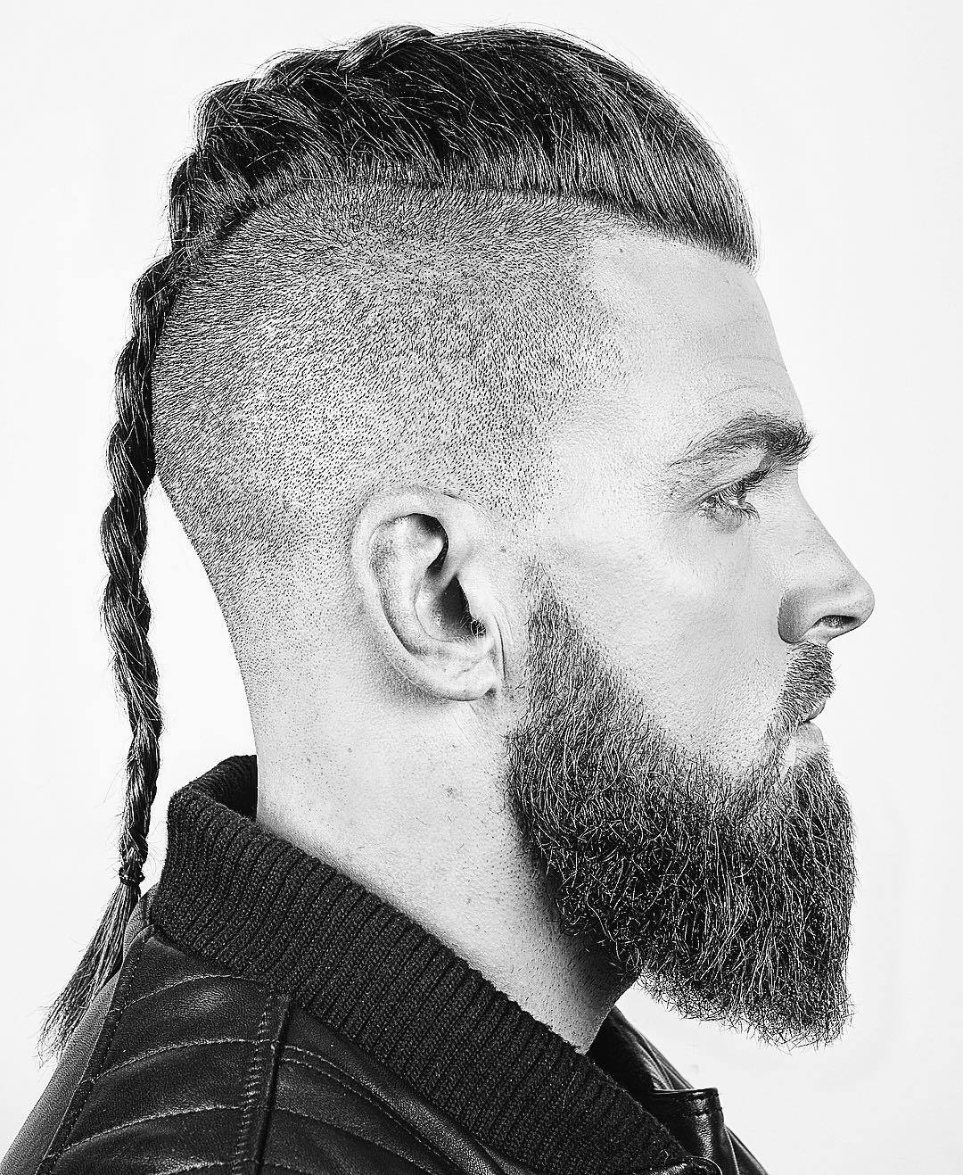 Man with viking braid and bald undercut with beard