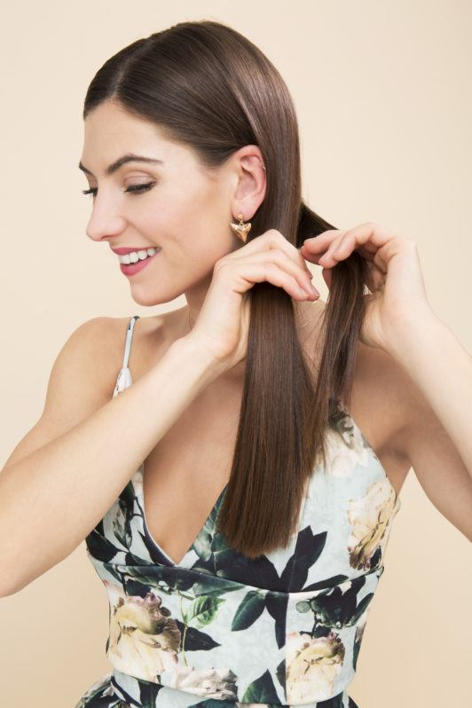 Side plait tutorial with brunette model smiling in flower dress