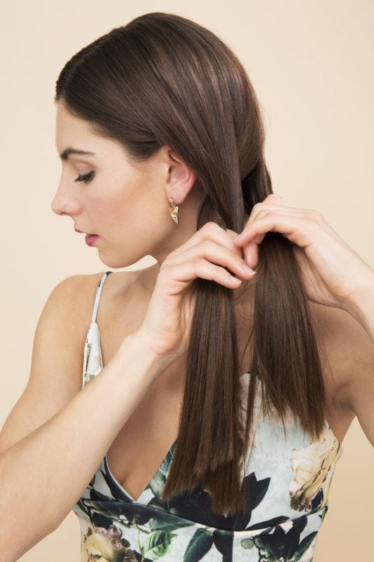 Side plait tutorial with brunette girl plaiting hair side profile