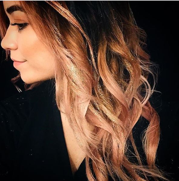 side view of dark brown ombre hair with glitter highlights