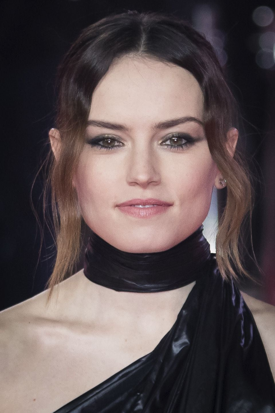 front view of daisy ridley with brown ombre hair in updo with loose long fringe