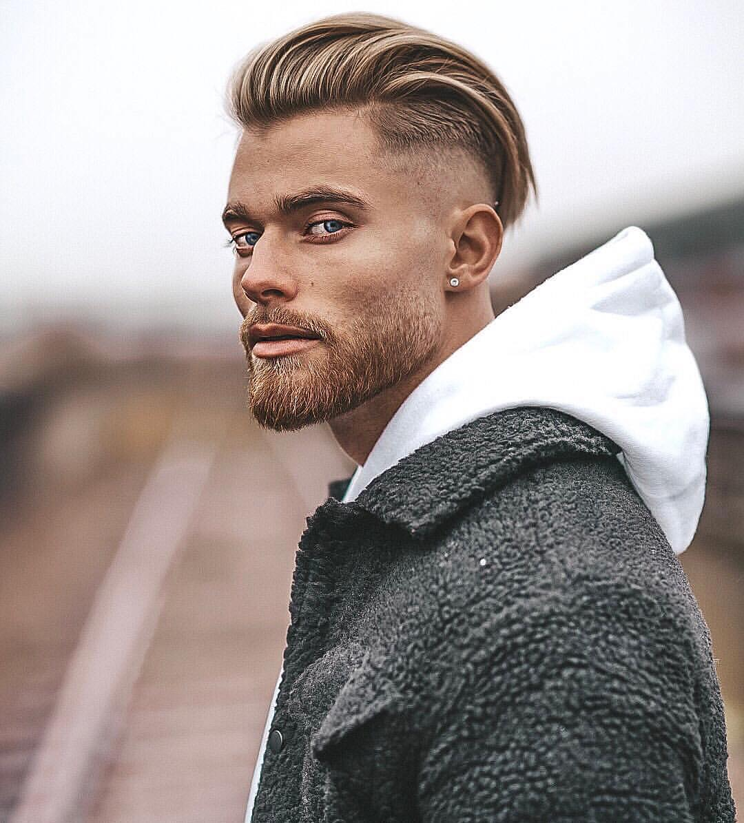 Man with swept back disconnected skin fade undercut