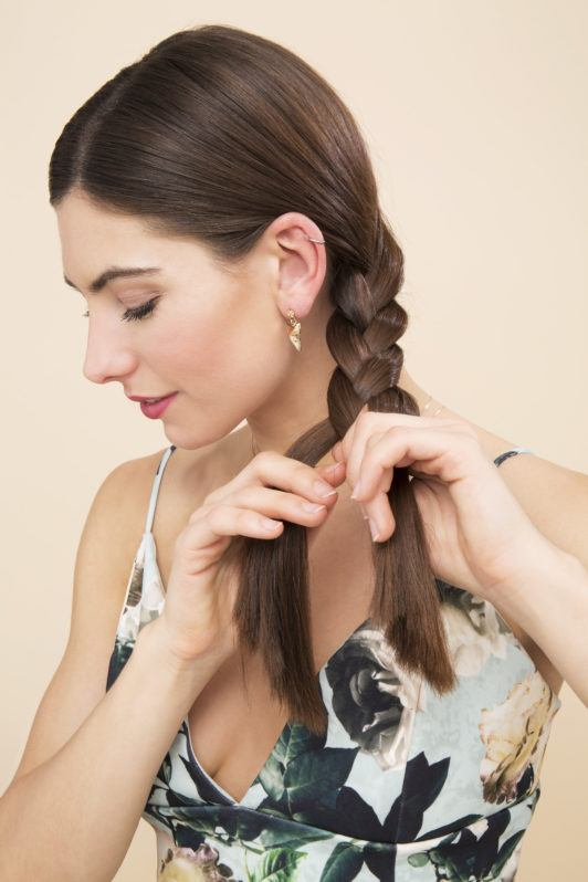 Side plait tutorial with brown haired girl plaiting her hair side profile