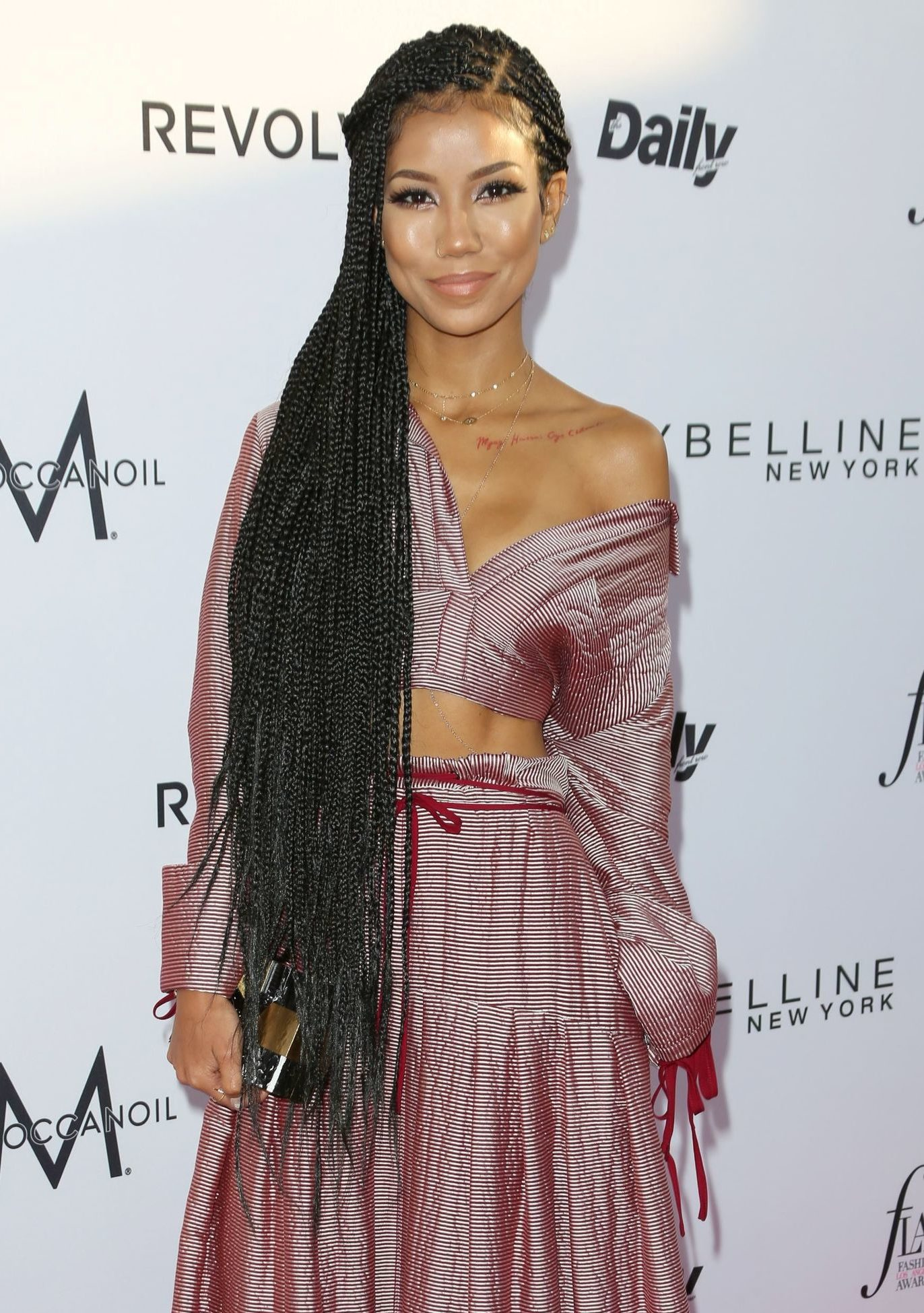 singer jhene aiko on the red carpet with hip length rapunzel braids