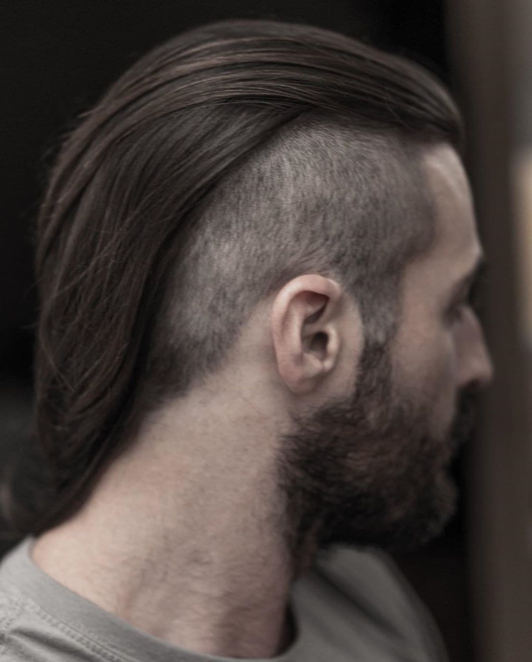 Man with long shaved hair with buzzed undercut