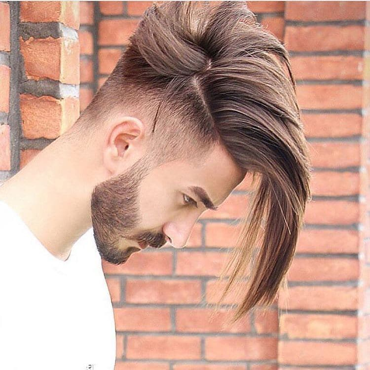 Man with long layered undercut hairstyle with smart beard