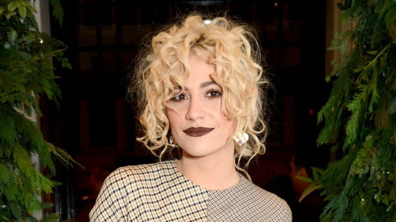 british pop singer pixie lott with blonde curly hair styled in an updo