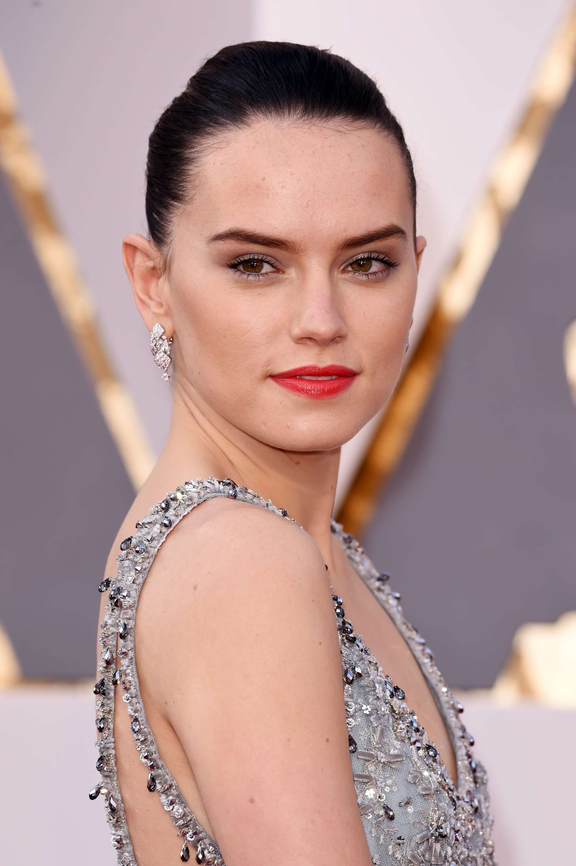 Daisy Ridley with a bun AKA Rey from Star Wars looking over her shoulder at the 88th Annual Academy Awards, Red Carpet Arrivals, Los Angeles, America - 28 Feb 2016
