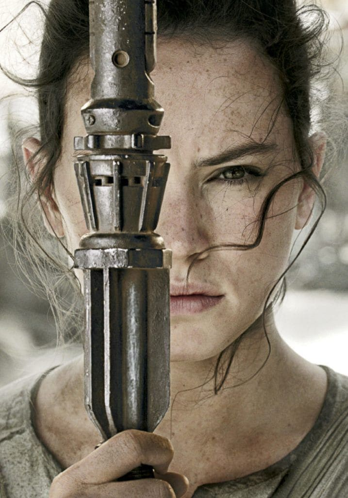 close-up of light saber and Daisy Ridley AKA Rey from Star Wars - The Force Awakens - 2015