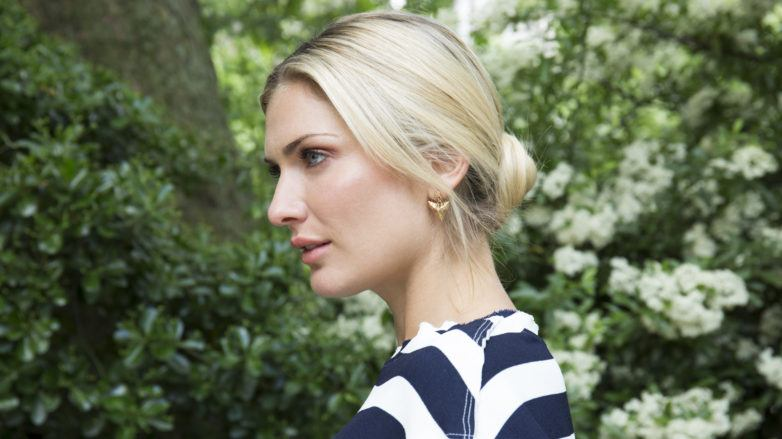 Blonde with a sleek, romantic low bun updo hairstyle