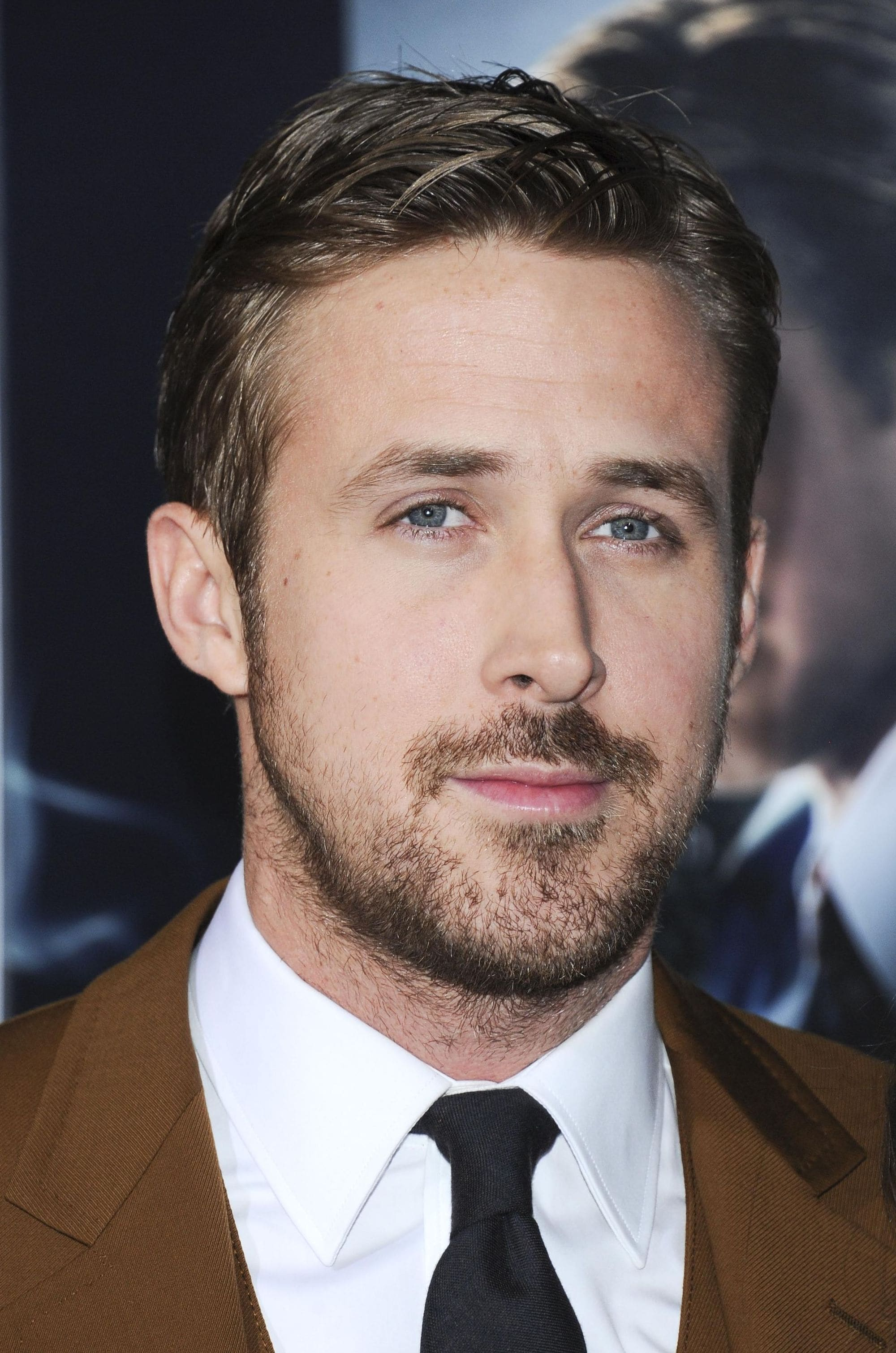 Ryan Gosling haircut: Ryan Gosling with brown hair in a side parting