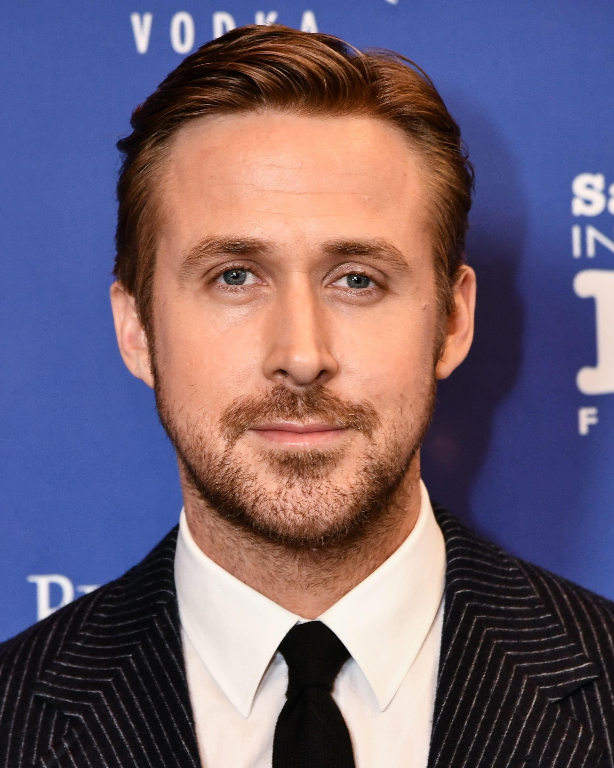 Ryan Gosling haircut: Ryan Gosling with an Ivy League haircut, wearing a suit