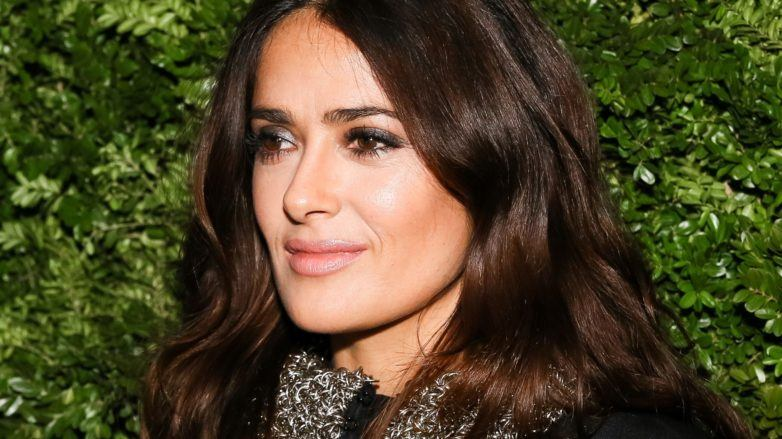 close up shot of Salma Hayek with brown wavy hair, on the red carpet