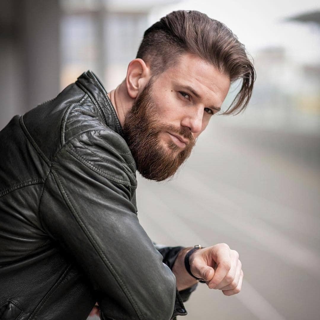Man with long slicked back undercut hairstyle with beard
