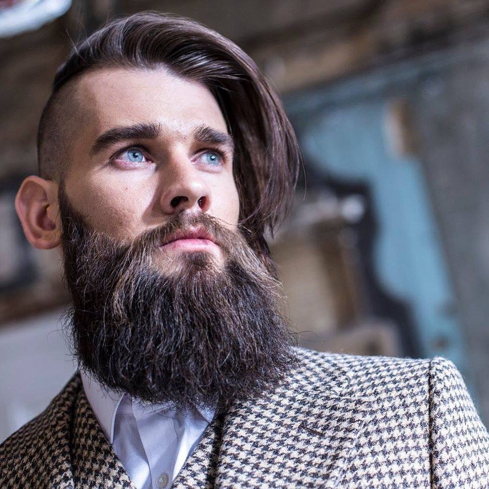 Man with beard and side-swept long undercut hairstyle