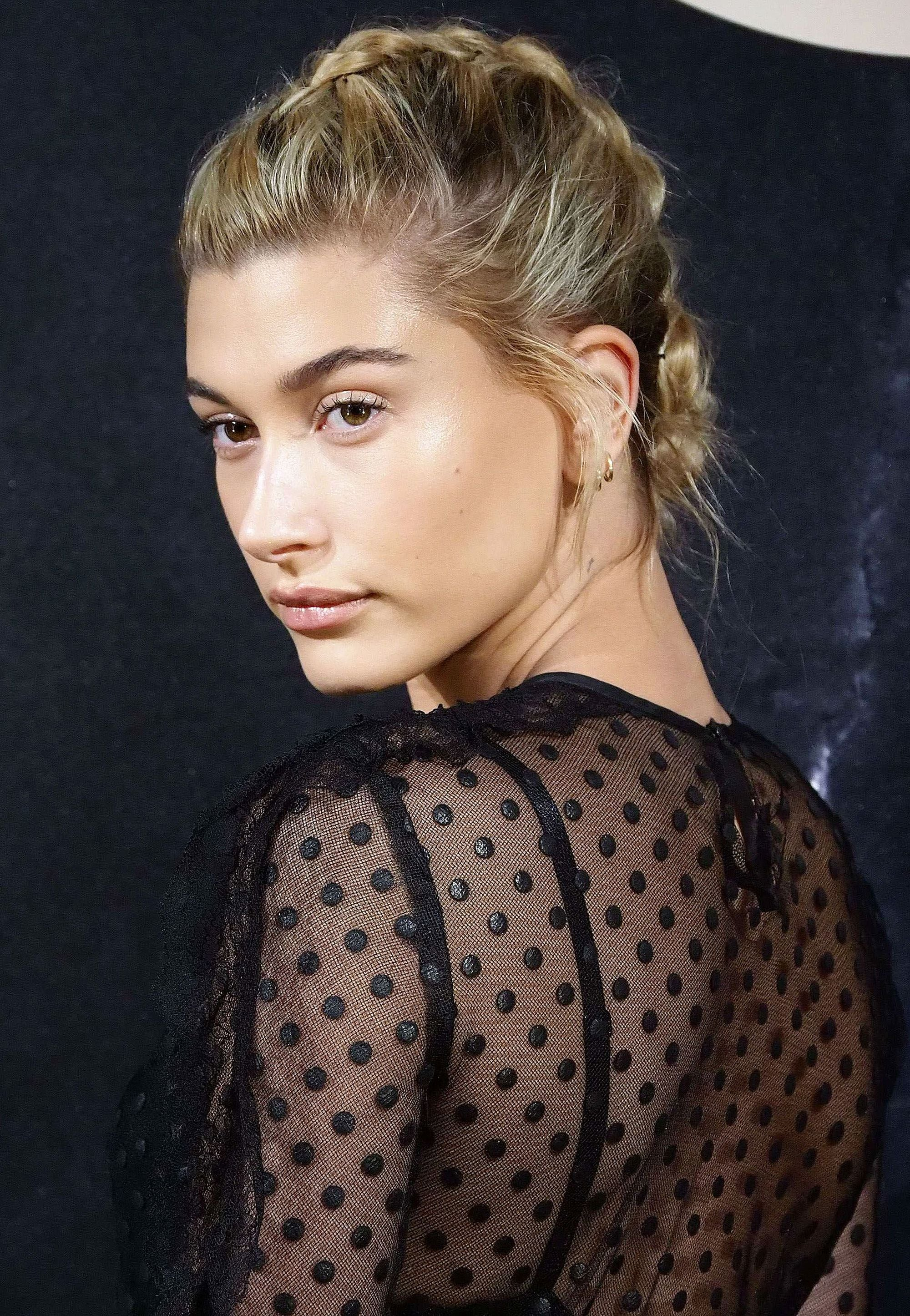 side view of hailey baldwin with blonde hair in french plait