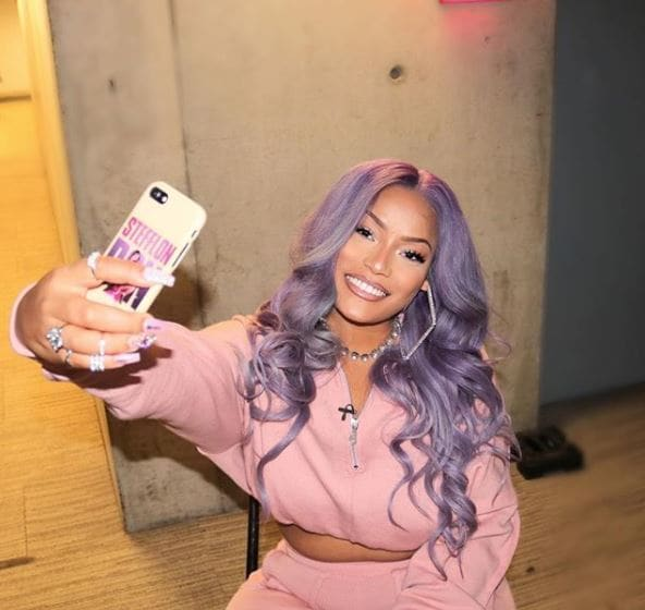 front view of stefflon don with pastel purple wavy long hair