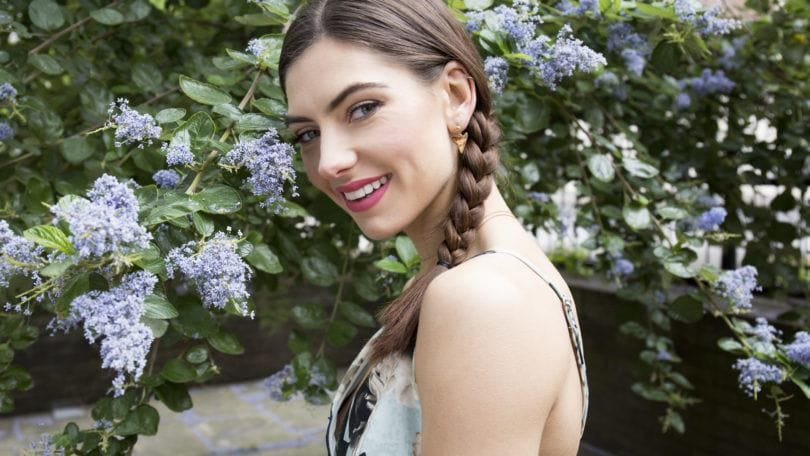 Side braid tutorial with brunette girl smiling at camera