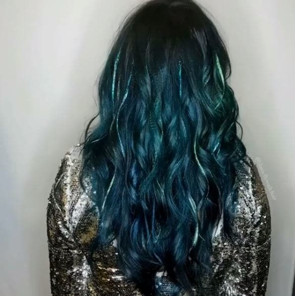 back view of emerald green wavy long hair with glitter highlights