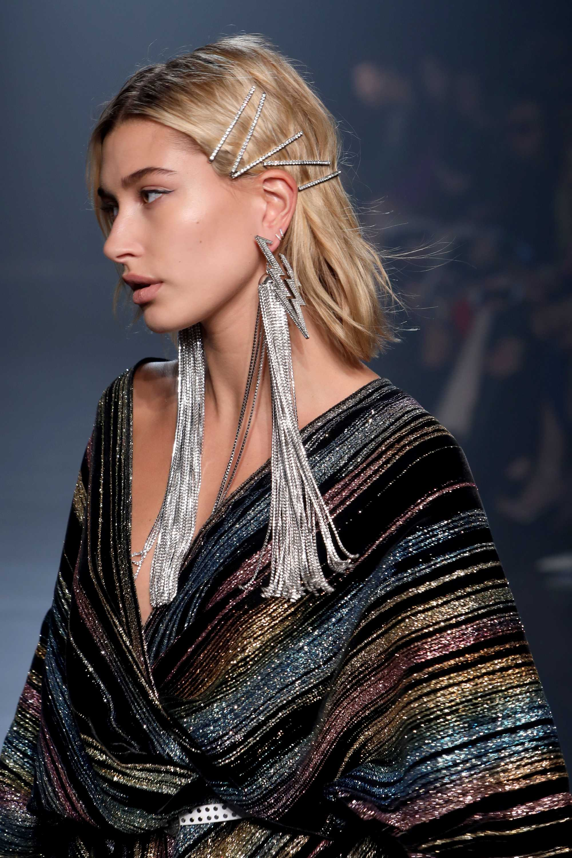 hailey baldwin blonde shoulder length hair with jewelled hair slides on catwalk