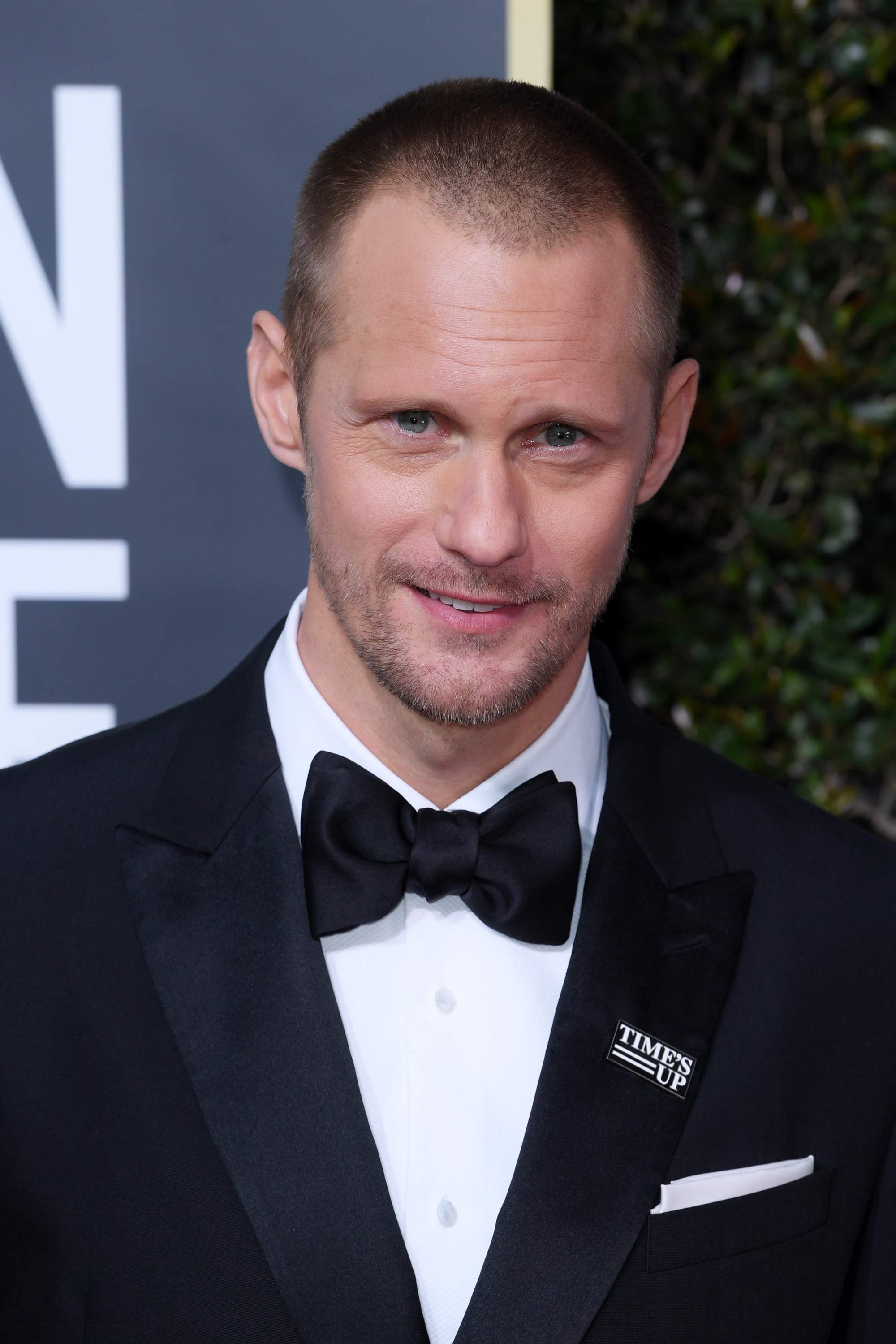 front view of alexander skarsgard with buzzcut dark blonde hair