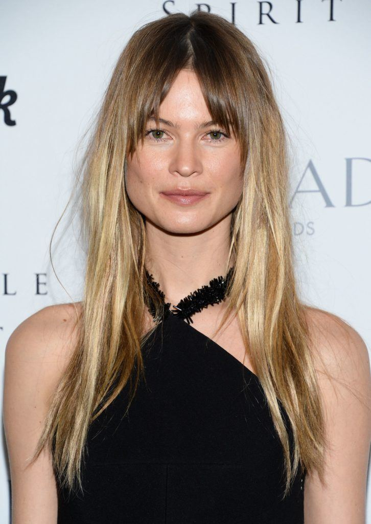close up shot of behati prinsloo with subtle shadow roots ombre hair with bangs, wearing black dress on the red carpet