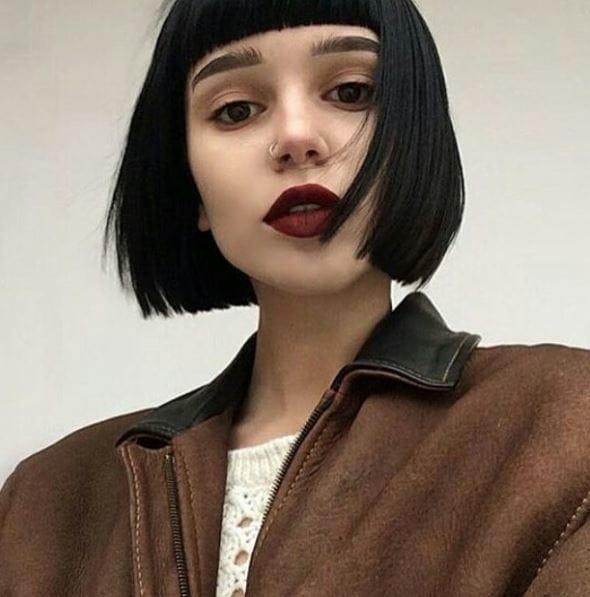 woman with dark hair micro bangs and bob