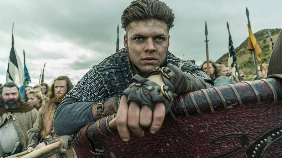 Viking hairstyles: Still of Vikings character with dark brown brushed back quiff with undercut on set