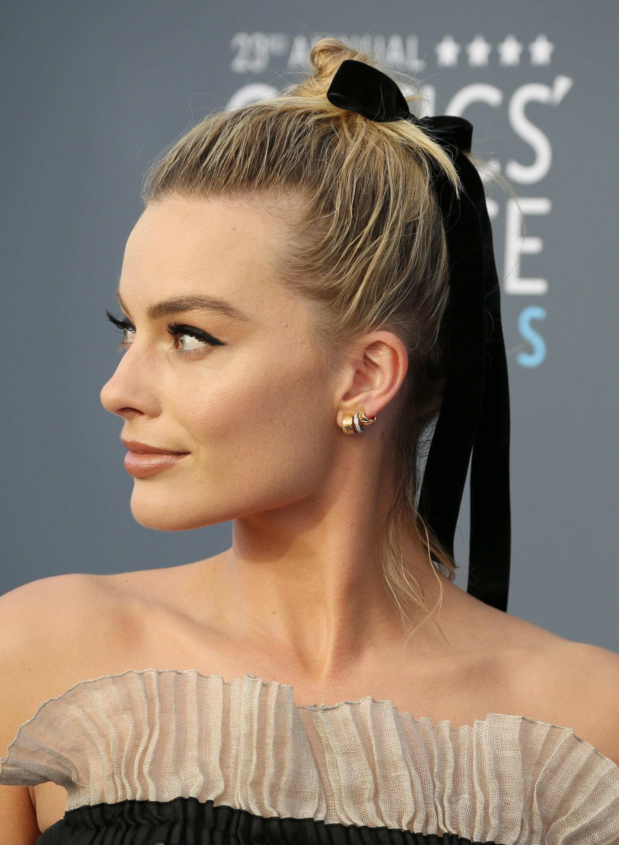 Ballerina Bun Margot Robbie at the Critics Choice Awards hair in bun with ribbon