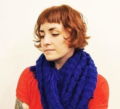 woman with auburn red bob hair with a micro fringe