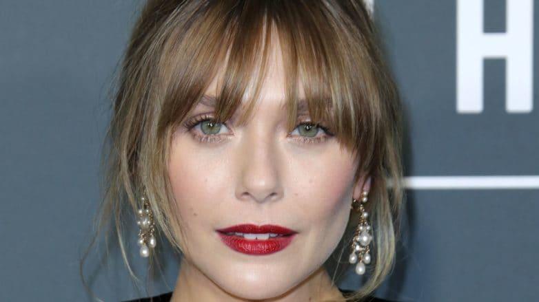 Should I get bangs: Elizabeth Olsen with wispy bangs, wearing
