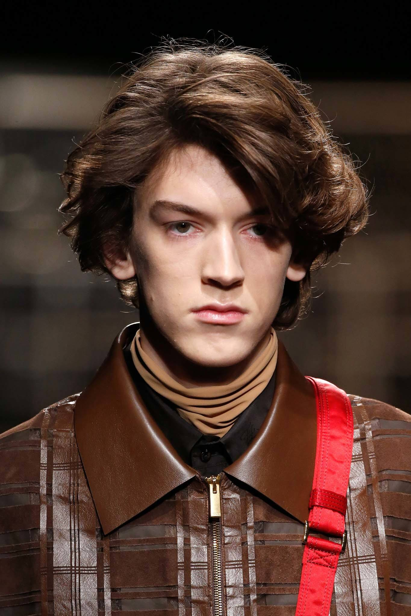 Milan Fashion Week Men's AW19: Brown haired male model with floppy mid-length hair
