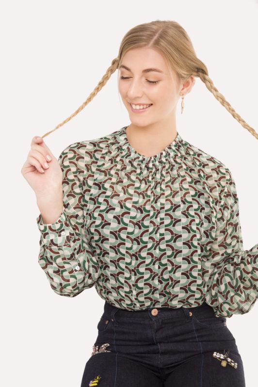 Braided updo blonde girl with braided pigtails looking down and smiling