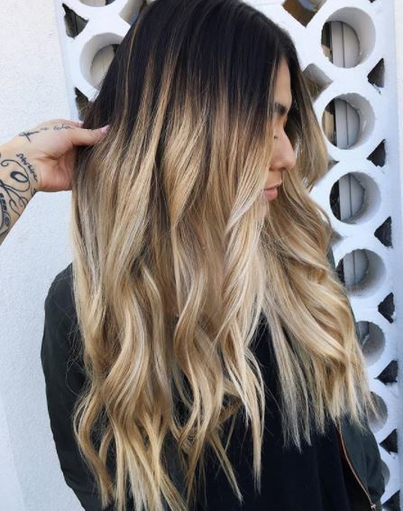 woman with long dark brown ombre hair