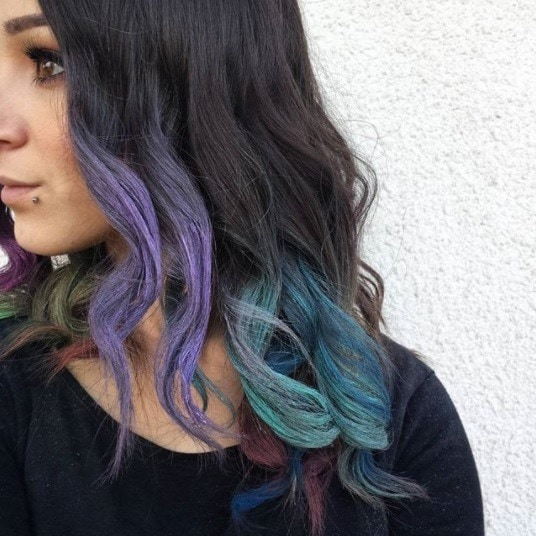 woman with dark brunette hair with purple and teal hair chalk ombre
