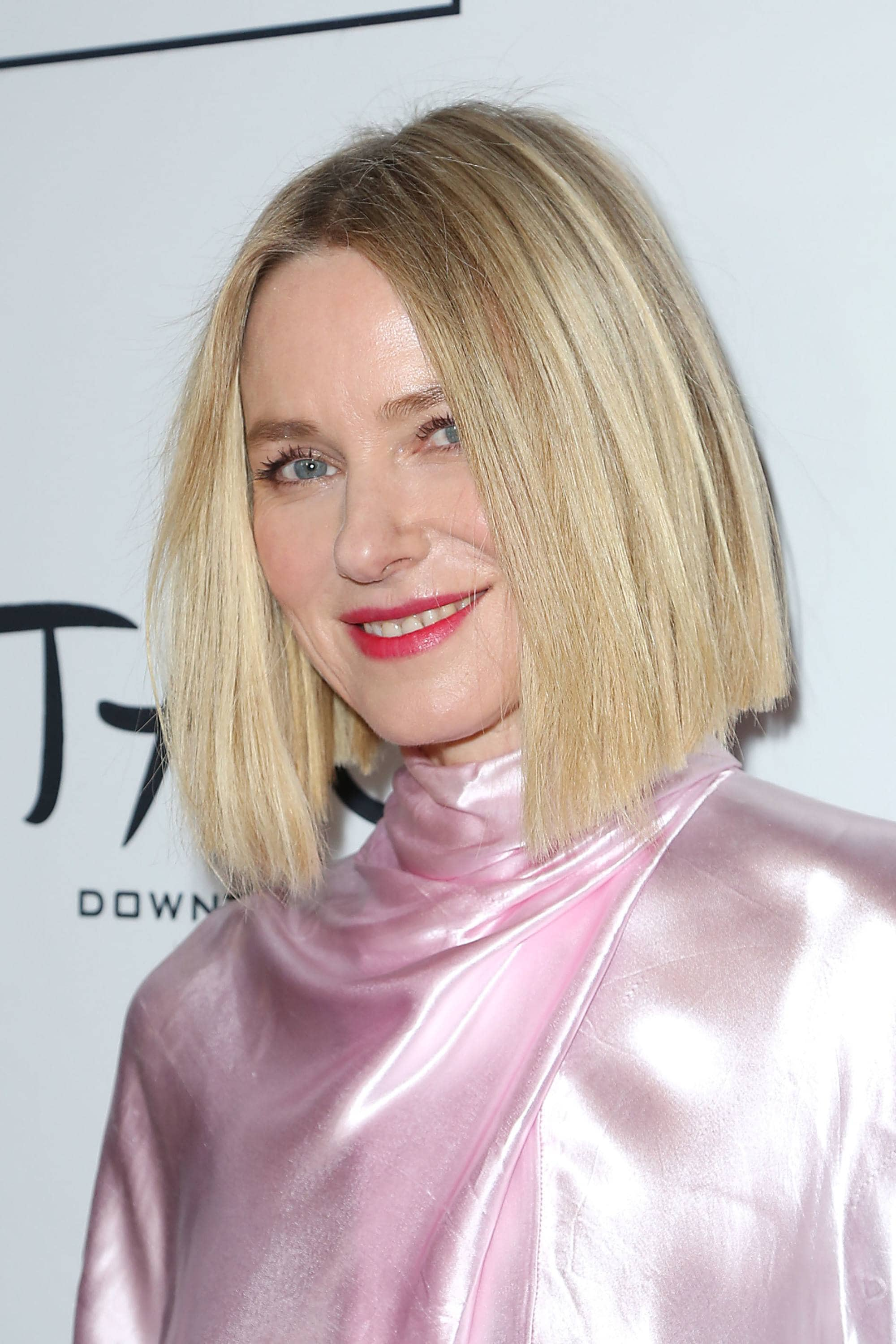 Angled bob: Naomi Watts with a blonde blunt angled bob, wearing a high neck silky pale pink dress