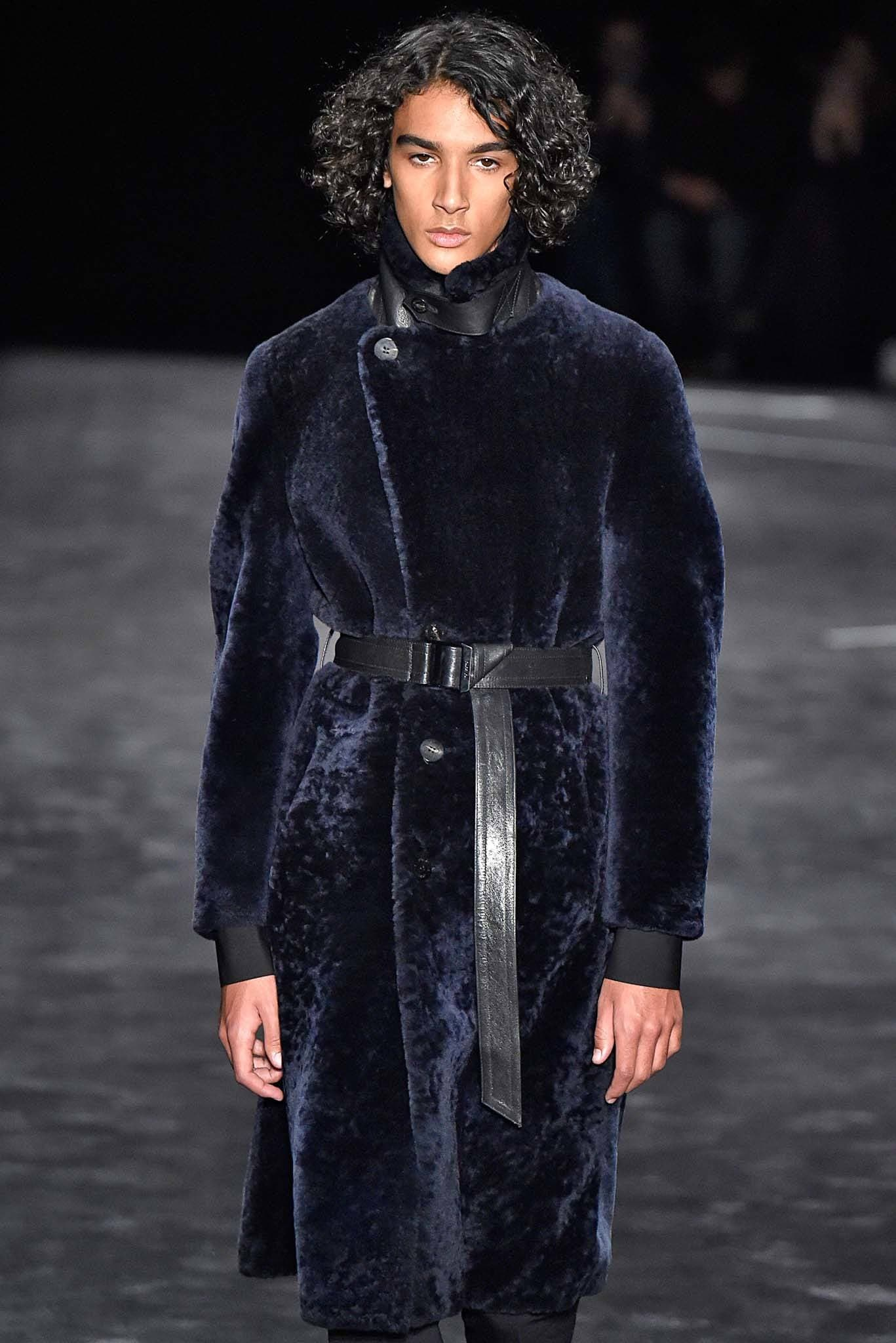 Milan Fashion Week Men's AW18: Male model on catwalk with curly brown hair