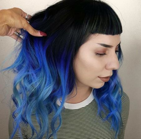 woman with dark brown hair with blue ombre finish