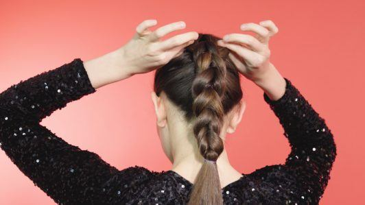 Brunette girl pancaking a pull-through braid
