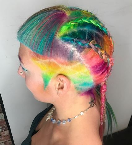woman with a patterned undercut, micro bangs and dutch braids
