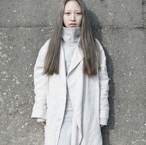 front view of woman with long light ash grey straight hair
