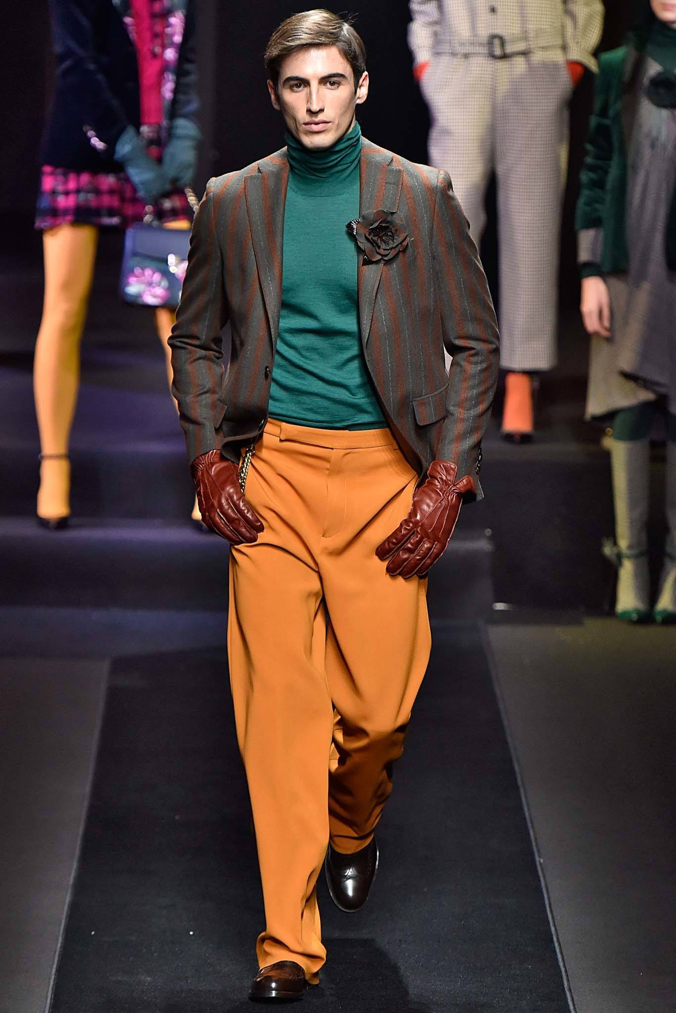 Milan Fashion Week Men's AW18: Male model on catwalk with side part comb over on light brown hair
