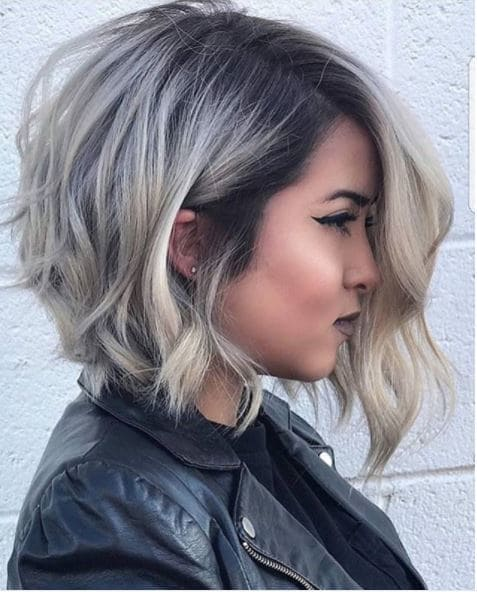 side view of blonde bob with dark roots