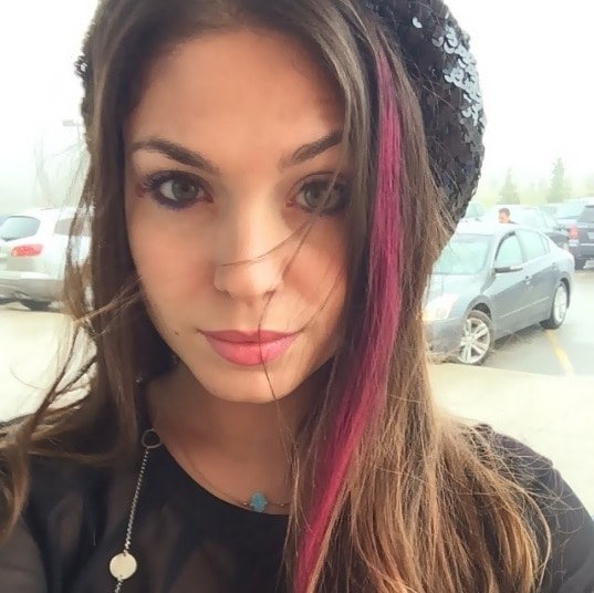 brunette woman with a hot pink steak of hair chalk