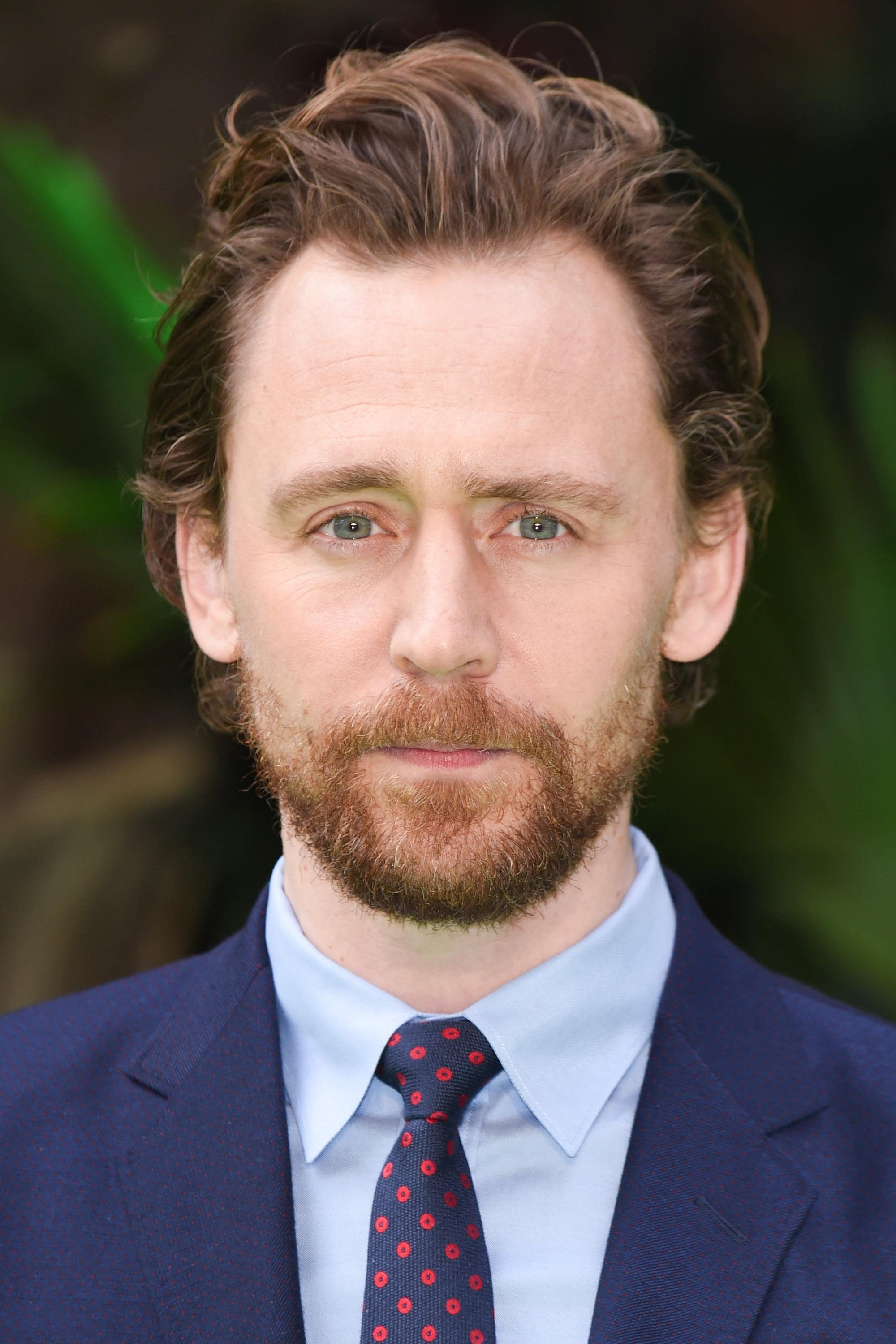 actor tom hiddleston at the early man world premiere with new rugged beard and longer hair
